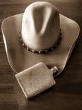 Cowboy Hat och silverflaska Fotografering för Bildbyråer