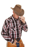 Cowboy hat over eyes hand in belt Stock Photo