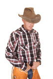 Cowboy hat over eyes hands in belt Stock Photos