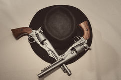 Cowboy hat and pistols. Pistols and hat from a cowboy Royalty Free Stock Images
