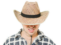 Cowboy hat pulled down over his eyes. Stock Photos