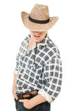 Cowboy hat pulled down over his eyes. Stock Photography