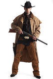 Cowboy with hat and rifle Stock Photos