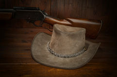 Cowboy hat and rifle Stock Photos