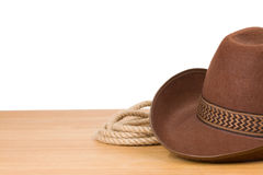 Cowboy hat and rope on white Stock Photo