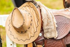 Cowboy hat, saddle strings, skirt, horse objects,. Cowboy hat, saddle strings, skirt, horse competition equipment. Taking care of animals concept stock photos