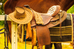 Cowboy hat, saddle strings, skirt, horse objects,. Cowboy hat, saddle strings, skirt, horse competition equipment. Taking care of animals concept royalty free stock photography