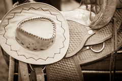 Cowboy hat, saddle strings, skirt, horse objects,. Cowboy hat, saddle strings, skirt, horse competition equipment. Taking care of animals concept stock image