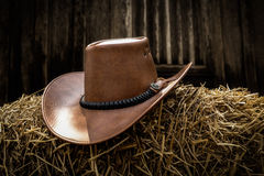 Cowboy hat. A cowboy hat on straw royalty free stock image