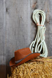 Cowboy hat on straw with ropes Royalty Free Stock Image