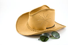 Cowboy hat and sunglasses Royalty Free Stock Photography