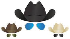 Cowboy hat sunglasses. A selection of country and western cowboy hats and aviator sunglasses Stock Photography