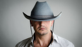 Cowboy hat is too big. Man wearing a cowboy hat that is too big for him; covering his eyes Stock Photography