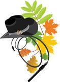 Cowboy hat and whip on the autumn background Stock Images