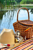 Cowboy hat, wicker basket, spool and fishing tackle royalty free stock images
