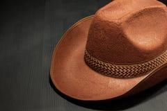 Cowboy hat on wood Stock Photos