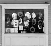 Cowboy hats hanging in store front shop Stock Photo