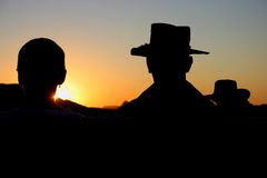 Cowboy hats in sunset Royalty Free Stock Image