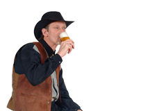 Cowboy having a beer Stock Photo