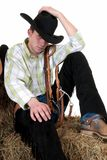 Cowboy on hay royalty free stock images