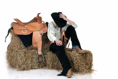 Cowboy on hay Stock Images