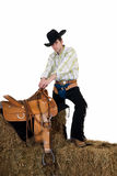 Cowboy on hay Royalty Free Stock Photos