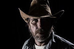 Cowboy. A head shot of a rugged cowboy Royalty Free Stock Photography