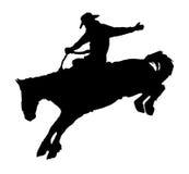 Cowboy het berijden paard bij rodeo. Royalty-vrije Stock Afbeeldingen