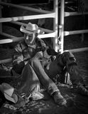 Cowboy with his dog Stock Images