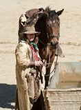 Cowboy and his horse Royalty Free Stock Photos