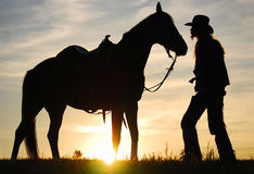 Cowboy with his horse Royalty Free Stock Photography