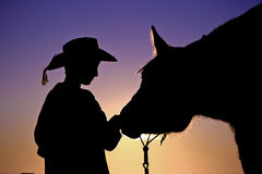 Cowboy & His Horse Silhouette Stock Images