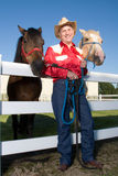 Cowboy With His Horses - Vertical Stock Photography
