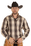 Cowboy hold belt black hat Stock Images