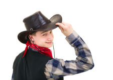 Cowboy holding his hand on his hat. Young handsome cowboy holding his hand on his hat  against isolated white background Royalty Free Stock Image