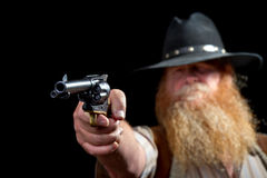 Cowboy holding his pistol up for the shot with his finger on the trigger Royalty Free Stock Photos