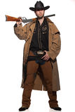 Cowboy holding a rifle Royalty Free Stock Photography