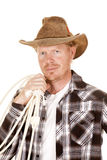 Cowboy holding rope over shoulder looking close Stock Photos