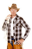 Cowboy holding rope over shoulder looking Stock Images