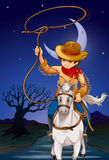 A cowboy holding a rope while riding a horse Stock Images