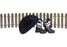 Cowboy Homestead. Shown by a hat and leather boots along a wooden fence - path included stock photo