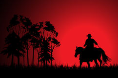 Cowboy on a horse 2. Cowboy on a horse over sunset stock illustration