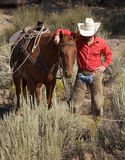 Cowboy and Horse Royalty Free Stock Image