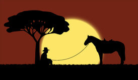 Cowboy with a horse. Cowboy is sitting near the tree and the horse is staying near him royalty free illustration