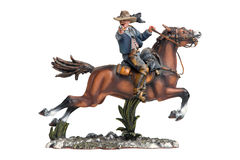 A cowboy on the horse. Tin statuette of cowboy on the horse stock photography