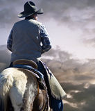 Cowboy and Horse on the Prairie Royalty Free Stock Images