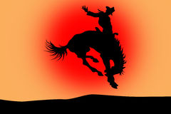 Cowboy on a horse in rodeo. On a red background Royalty Free Stock Image
