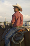 Cowboy on horse with rope Stock Photo
