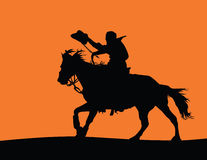 Cowboy on a Horse Silhouette. Detailed vector silhouette of a cowboy riding a horse (cowboy and horse is a separate shape from the ground Stock Photo