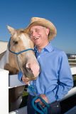 Cowboy with Horse - Vertical Royalty Free Stock Photo